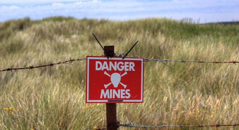 A warning sign about a minefield